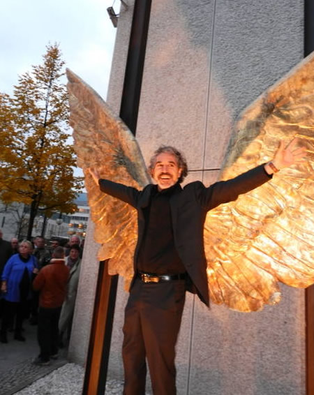 Mexican artist Jorge Marín poses in front of his wings sculpture, Berlin