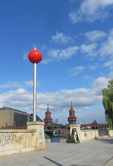 The 'Signalkugel' sculpture on the May-Ayim-Ufer, Berlin, which rises and falls as river traffic passes on the Spree.