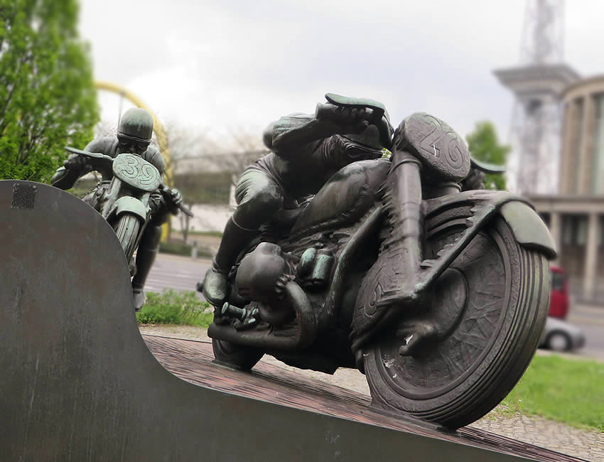 A bronze monument located on Berlin's  Messedamm / Halenseestraße commemorates the intrepid speed racing cyclists of the AVUS circuit