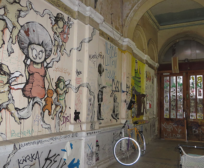 Art and grafitti covered entrance hall, Berlin